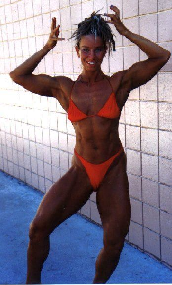Suzanna's past bodybuilding times, double biceps pose