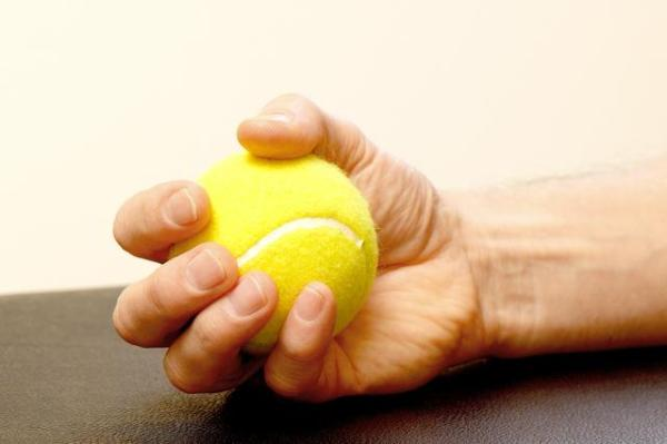 tennis ball squeezes to heal the wrists