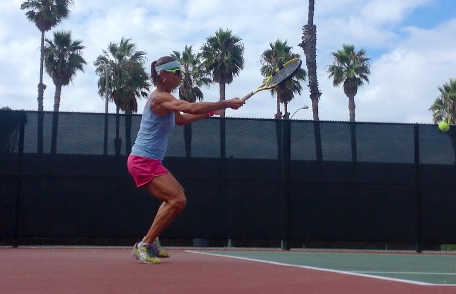Suzanna McGee hitting a powerful forehand… learn how to improve tennis swing power