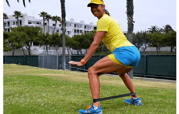Strengthen the glutes with monster walk (lateral band walk)