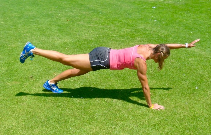 strong core with a plank with arm and leg lift